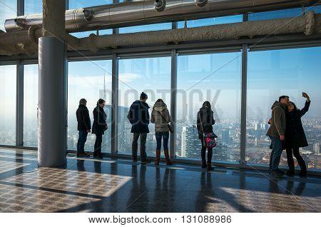 Milan Italy - February 8 2015: Porta Nuova visitors in Palazzo Lombardia