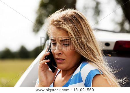 Young woman calling for help