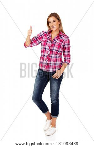 Young smiling woman with thumb up