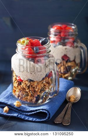 homemade granola and chia seed pudding with berry healthy breakfast