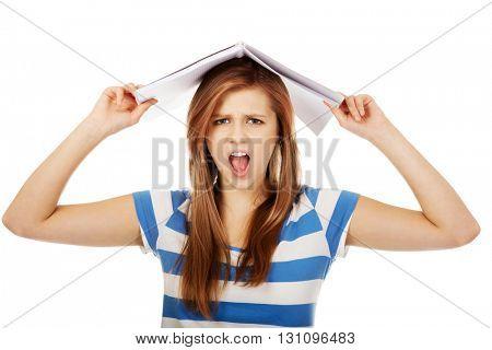 Frustrated teenage woman screaming