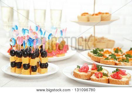 Set of cold snacks, canape, beverages, closeup