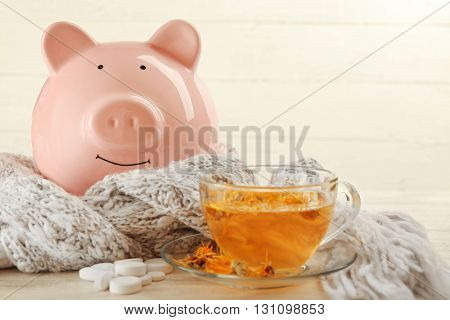 Decorative pig with scarf and pills. Swine Flu concept
