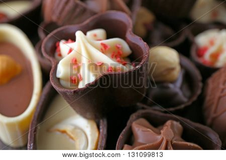 Delicious chocolate candies background, close up