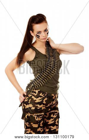 Serious military woman with bullet belt