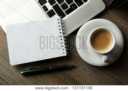 Empty  notebook on laptop keyboard, on light background