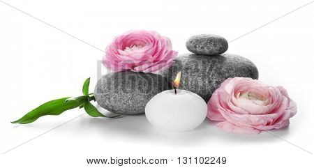 Spa still life with pebbles, flowers and candle isolated on white