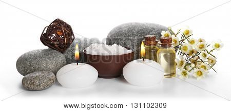 Spa still life with pebbles and candles isolated on white