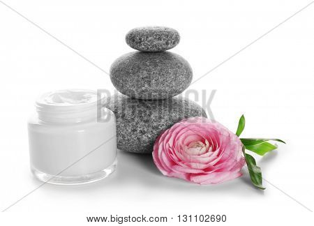 Spa still life with pebbles and cream isolated on white