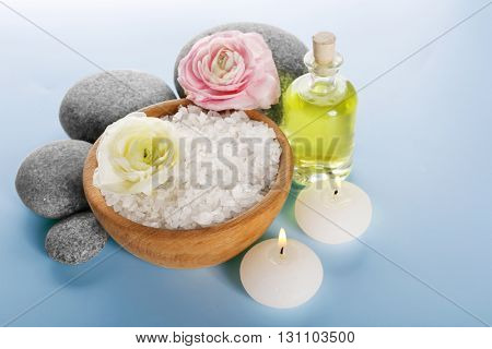 Spa still life with pebbles and candle isolated on white