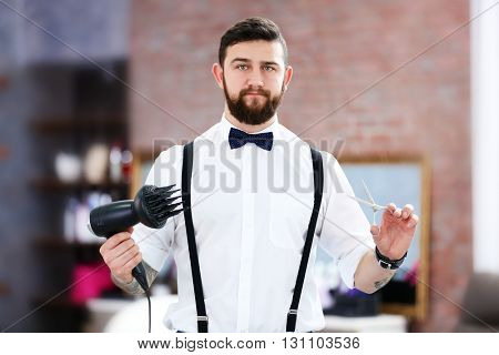 Stylish barber with hairdryer