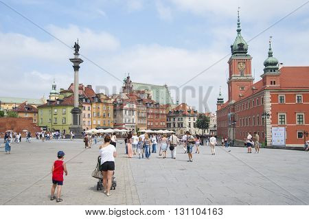 Poland, Warsaw - July 8, 2012: Tourists At The Palace Square In The Heart Of Warsaw..
