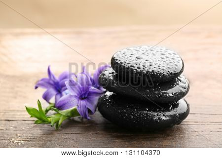 Stack of spa hot stones on wooden table