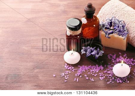 Spa composition with spring flowers on wooden table