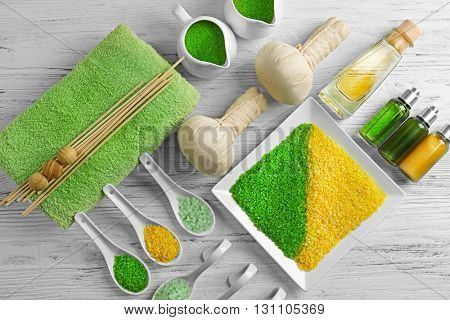 Spa ingredients on a white table, top view