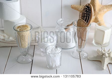Bath accessories on wooden wall background