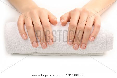 Woman hands with beautiful manicure on white towel