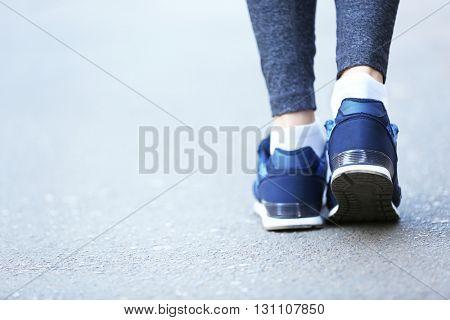 Sports woman legs in running movement