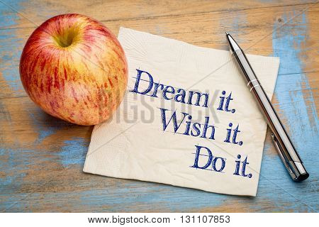 Dream it, Wish it, Do it, Handwriting on a napkin with a fresh apple,