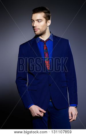 Fashion shot of a handsome man wearing elegant suit. Men's beauty, fashion. Business style.