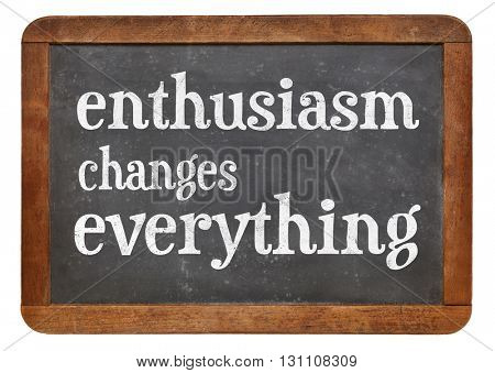 Enthusiasm changes everything - white chalk text on a vintage slate blackboard