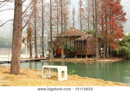 White Chiar And House On Water Front Property
