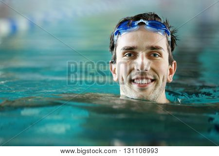 Head of handsome man in the swimming pool