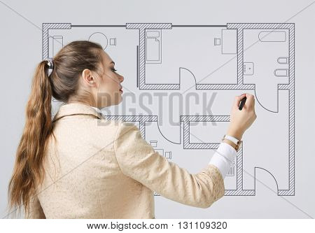 Female architect working with a virtual apartment plan