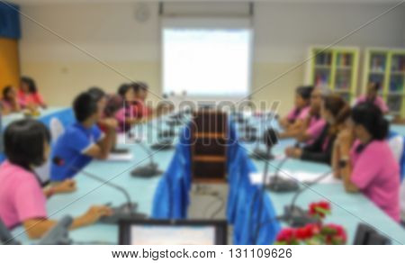 blur blurred abstract at Business students and  screen Projector,  education training conference hall or room seminar meeting People, Analyzing Statistics Financial Concept with attendee background