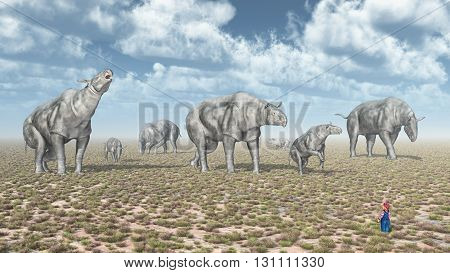 Computer generated 3D illustration with a group of Paraceratheriums and a child