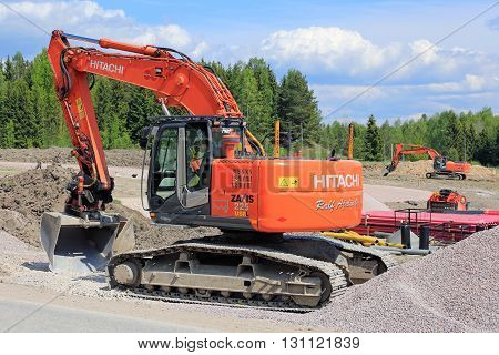 VIHTI, FINLAND - MAY 21, 2016: Hitachi Zaxis 225 USRL crawler excavator by a construction site in South of Finland. The 225USRL is a medium excavator with operating weight of 23600-24900 kg.