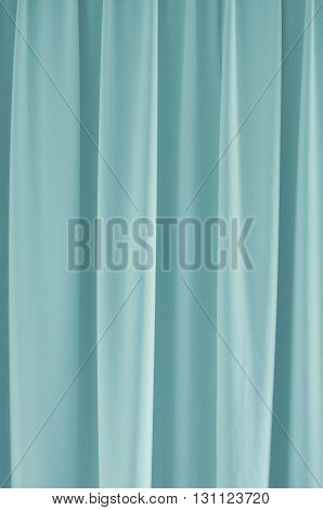 Light blue closed curtain for background and texture.