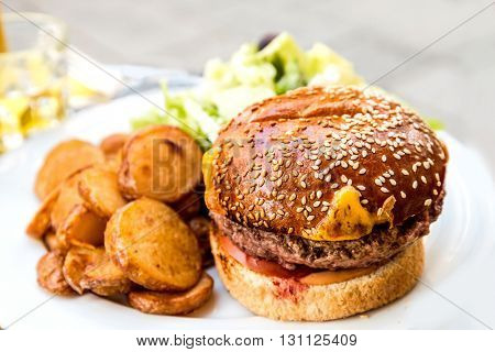 Cheese burger - American cheese burger with Golden French fries potatoes