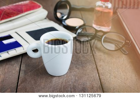 White Cup Hot Black Coffee On Wood Table With Working Women Things