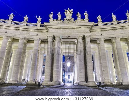 Italy, Rome, Piazza San Pietro - Colonnade of St. Peter's Square in the night