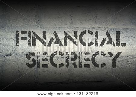 financial secrecy stencil print on the grunge white brick wall