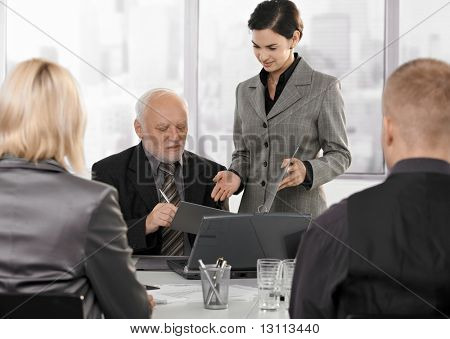 Secretary getting contract to sign by senior executive at businessmeeting.?