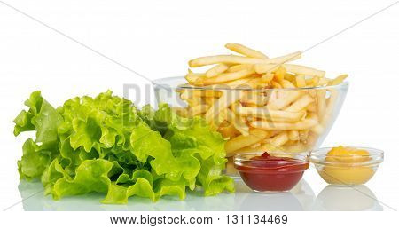 Lettuce, a bowl of French fries and sauces isolated on white background.