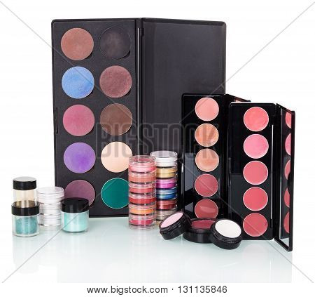 Sets of eye shadow, lip gloss, blush and powder isolated on white background.