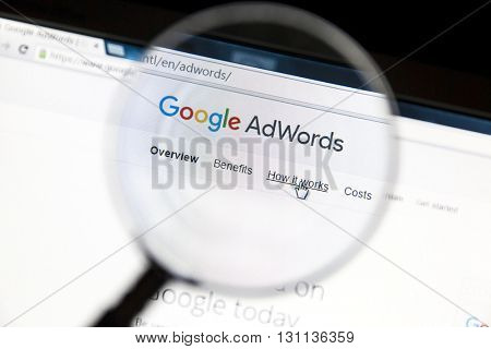 Ostersund, Sweden - May 23, 2016: Google Adwords website under a magnifying glass. Google AdWords is an online advertising service.
