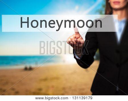 Honeymoon - Businesswoman Hand Pressing Button On Touch Screen Interface.