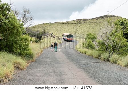 Masaya Nicaragua - July 24 2015: Tourists hike up the road towards the craters of Masaya and Nindiri volcanoes on July 24 2015 in Nicaragua