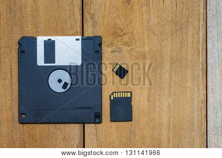 Diskette SD card Micro SD card and memory were put together on wood board