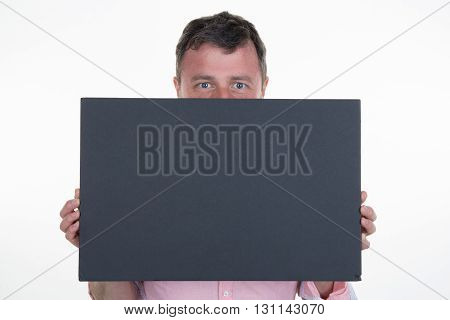 Man with a blanck black board isolated
