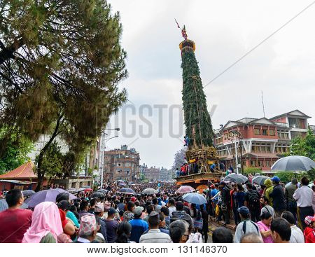 PATAN, NEPAL - MAY 10, 2016: God of Rain Rato Machhindranath chariot festival. Rato Machhindranath is worshiped as the god of rain. The chariot is pulled through the street of Patan for about a month.