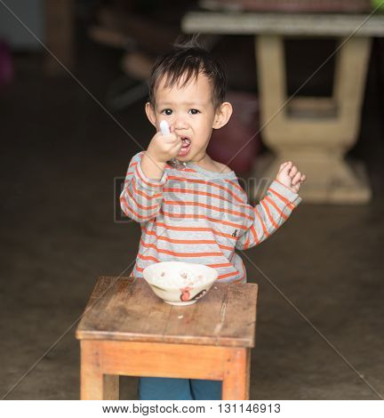Asian Baby Boy Eating Fried Rice By Spoon By Him Self