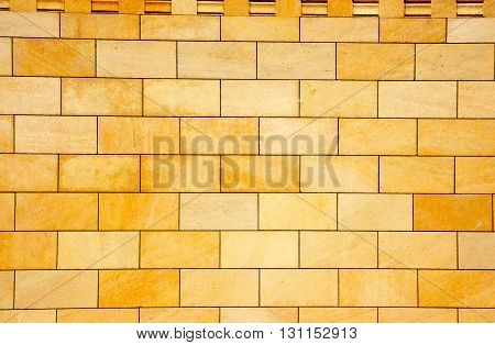 the wall is revetted with a decorative yellow facing tile