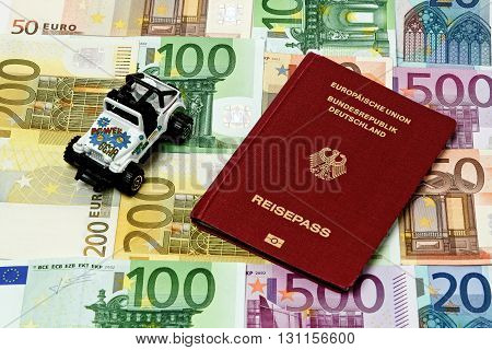 Different Euro Bills 500 200 100 50 Euro Banknotes Lying On A Table. On Top Of The Money Lies A Car