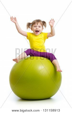 child girl doing gymnastics with fit ball over white background
