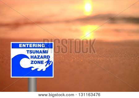 Tsunami Sign On Blur Sunset Beach